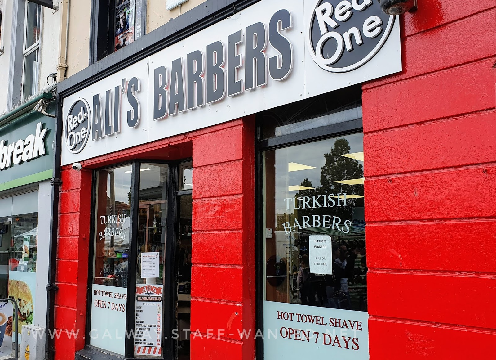 Shopfront of Turkish barber open seven days offering how towel shaves in the middle of Galway city