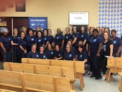Group shot of faculty team at Feed My Starving Children