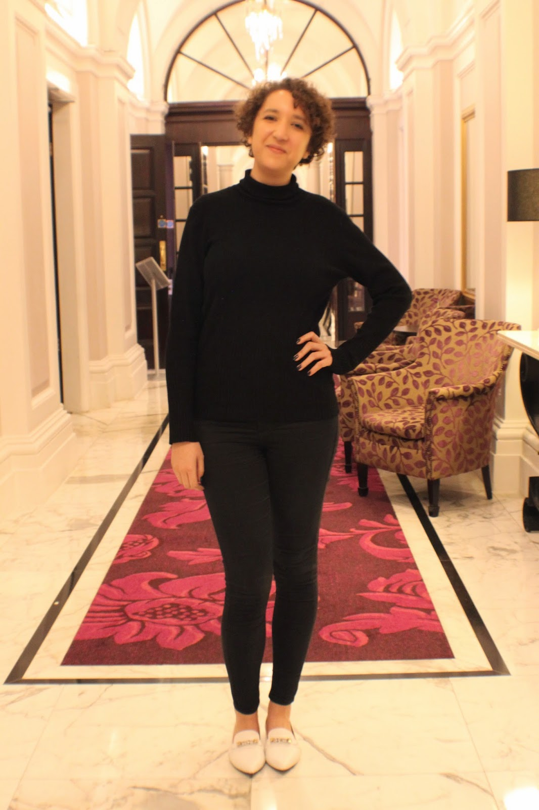 woman in all black outfit with white shoes