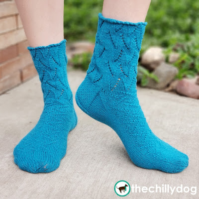 Riptide Socks Knitting Pattern featuring Cobasi by HiKoo yarn in Skacel 2020 Color of the Year, Kind of a Big Teal