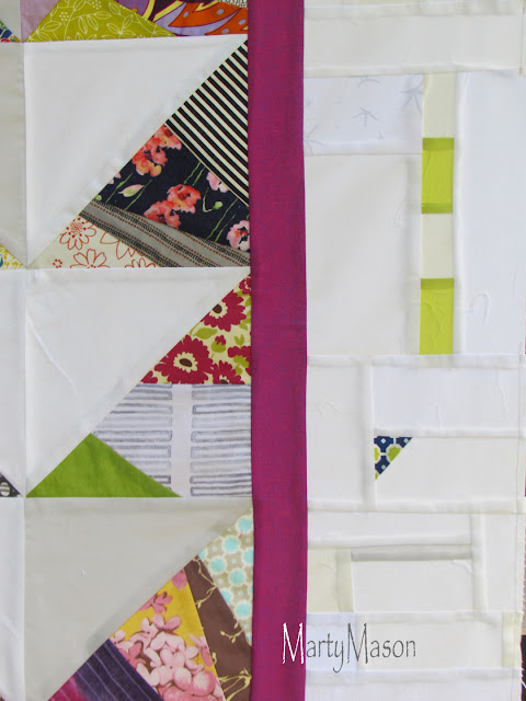 A quilt - patched triangles with improv patched borders - marty mason