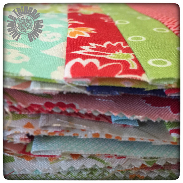 A stack of cut blocks for the Bonnie and Camille Log Cabin Block Swap by Thistle Thicket Studio