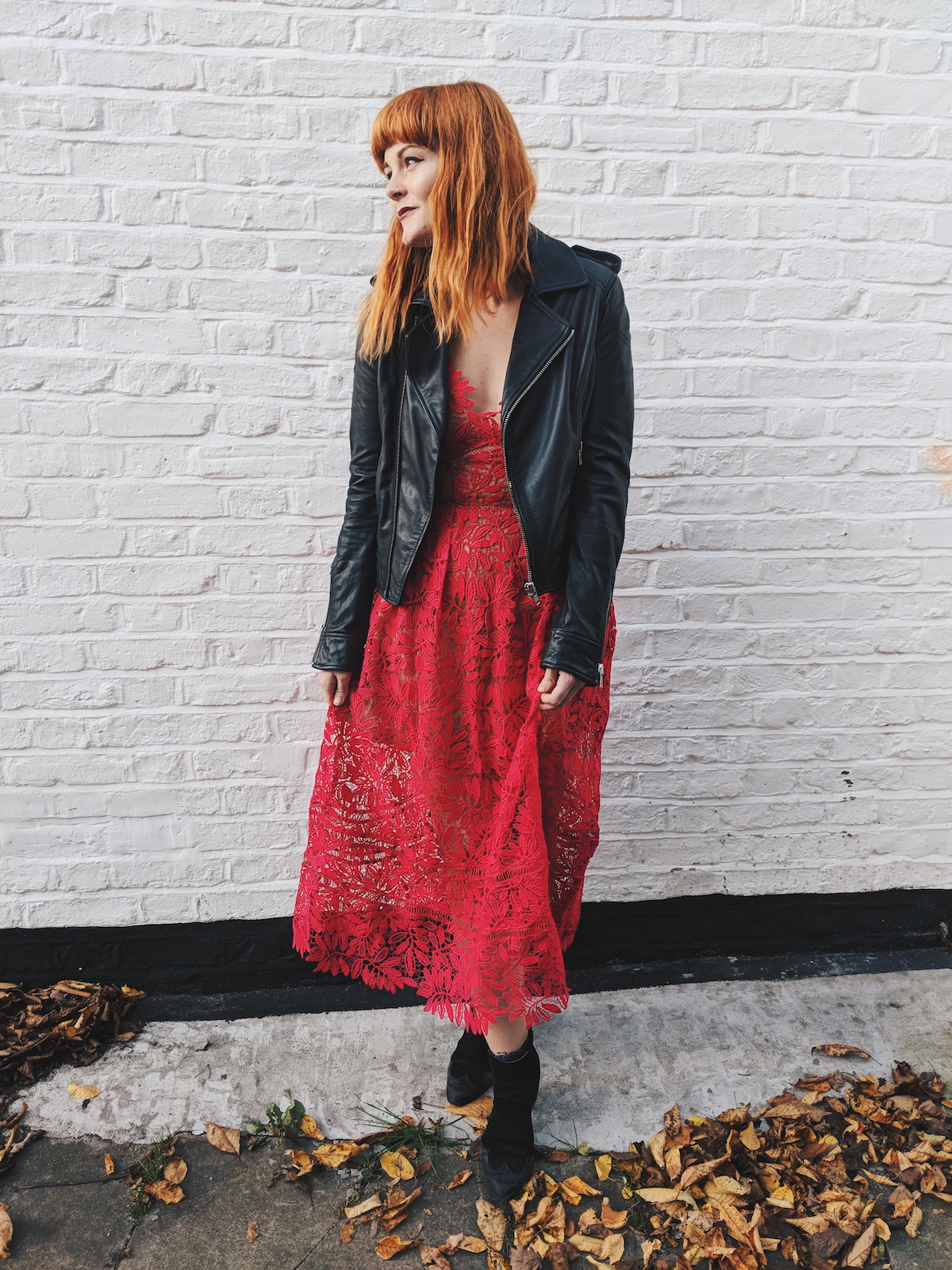 Teaming a formal dress with a biker jacket and ankle boots instantly dresses an outfit down for an effortless look