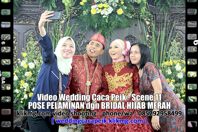Pose Pelaminan dengan Bridal Hijab Merah | Video Wedding Caca PX / Chaca Peik - Scene 11 | klikmg.com video shooting purwokerto