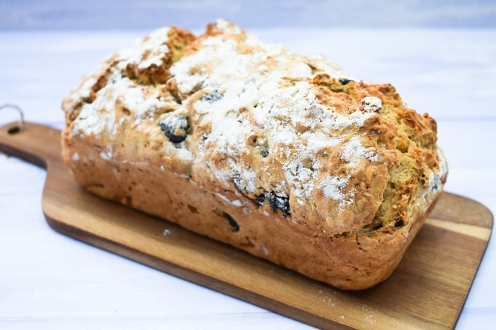 No Knead Black Olive Beer Bread on wooden board