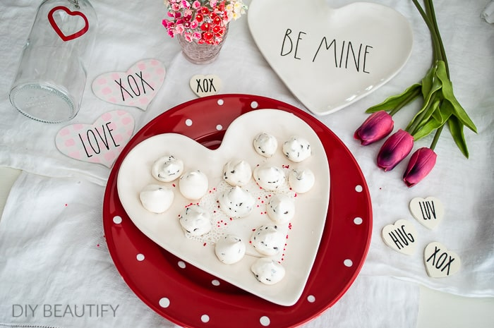 heart plate topped with chocolate chip meringue kisses