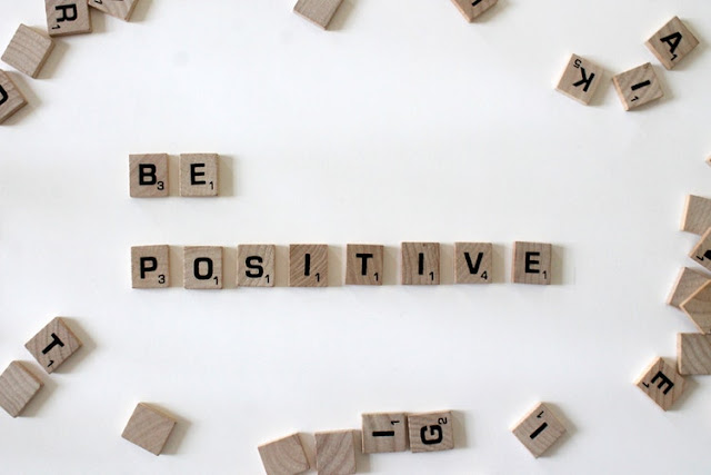 Scrabble letters to read 'be positive'