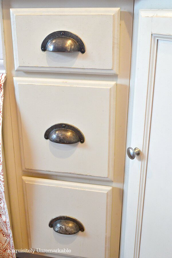 Bisque Kitchen Drawers With Traditional Silver Cup Pulls