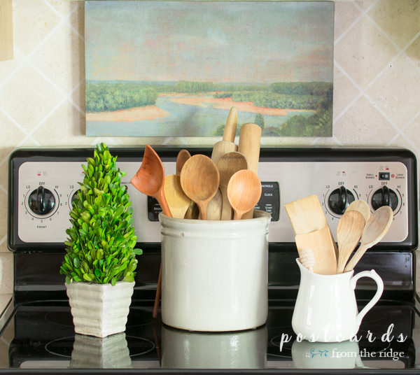 vintage wooden kitchen utensils and preserved boxwood topiary