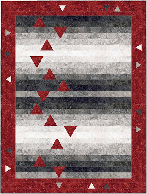 Quilt with black and grey precut strips with inset red accent triangles and a red border with inset triangles.