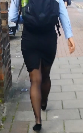 First Up A Brunette Wearing Black Pencil Skirt