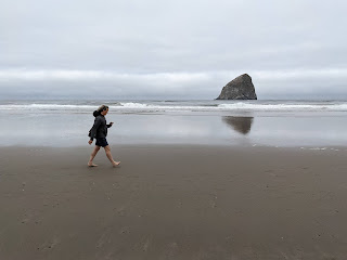 A brisk beach walk with Haystack rock in the background, Pacific City Oregon.