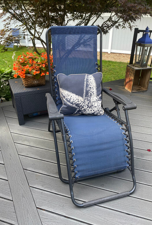 Blue zero gravity chair with starfish pillow