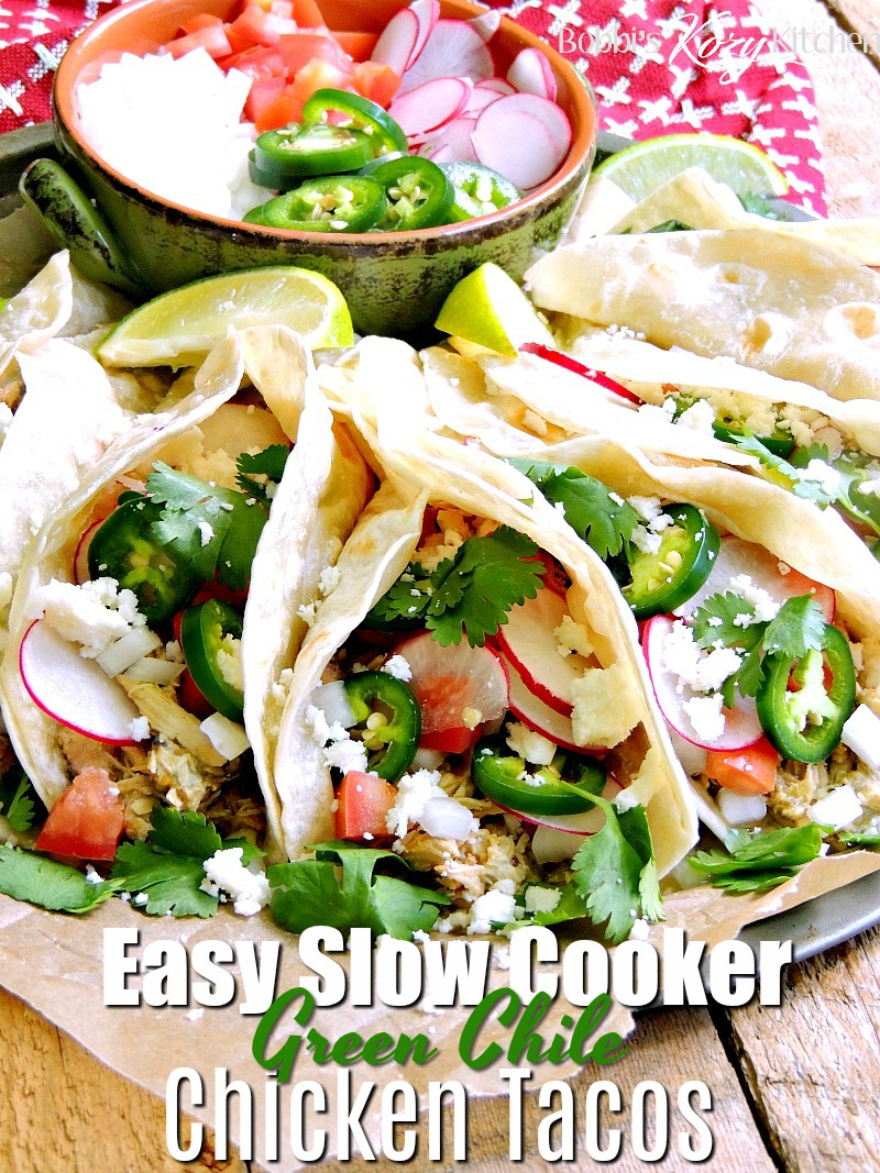 This Creamy Slow Cooker Green Chile Chicken Taco recipe is easy to make and perfect for those busy nights you don't have time to cook for the family. BONUS it is low carb/keto-friendly! #slowcooker #crockpot #lowcarb #keto #greenchile #chicken #tacos #easy #recipe | bobbiskozykitchen.com