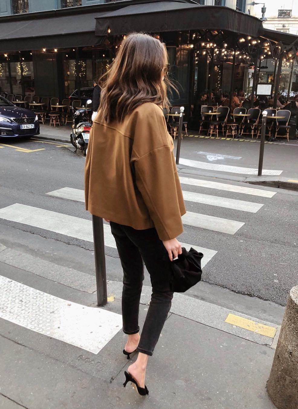 Viral Instagram Look — Spring outfit idea from Felicia Akerstrom in a cropped camel jacket, skinny black jeans, and black mule kitten heels