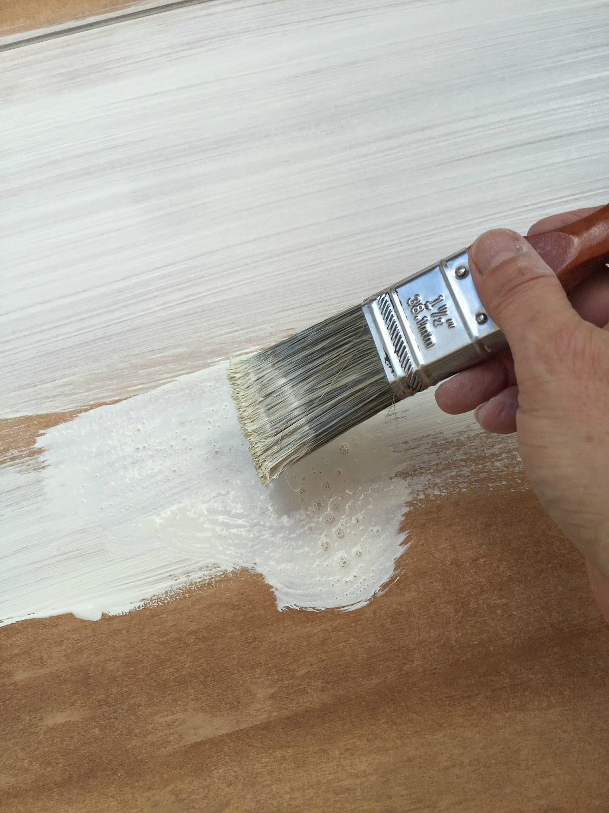 Dilute the paint with water to achieve a thin consistency