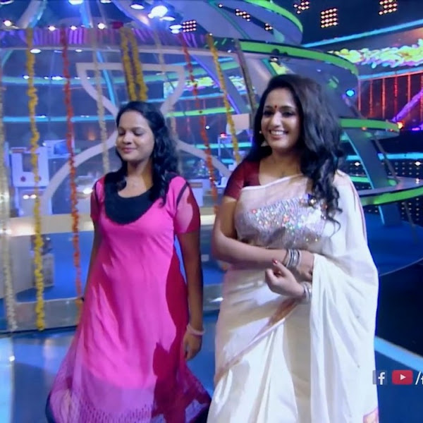 Kavya Madhavan latest hot photos in saree from Smart Show in Flowers TV