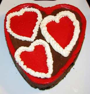 heart shaped chocolate cheesecake with red hearts baked in