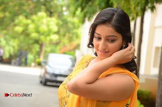 Actress Mouryani Pictures in Yellow Long Dress at Ardhanaari Teaser Launch  0176.JPG