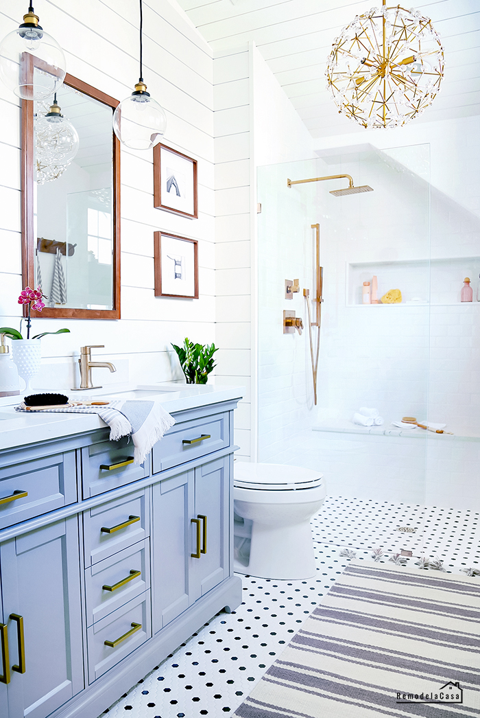 white and gray bathroom with shiplap on wall and ceiling