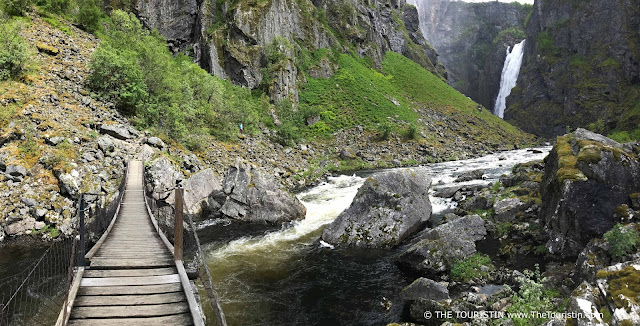 On a suspension bridge with Vøringsfossen waterfall as a background