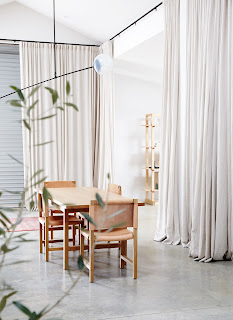 neutral floor to ceiling curtains with black iron rods
