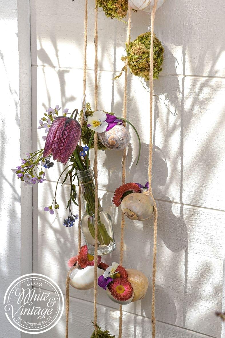 Girlande aus Naturmaterialien für Terrasse oder Balkon.