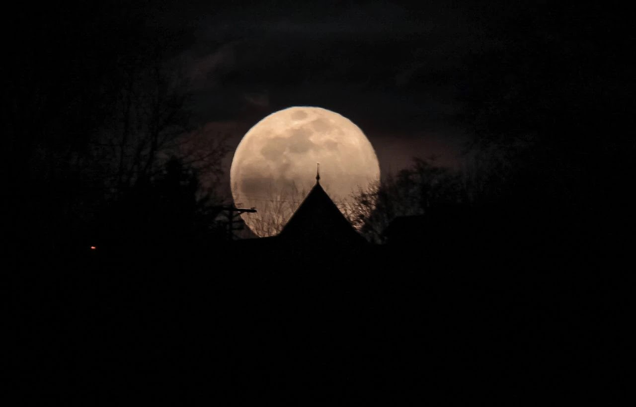 A supermoon rises over Phillipsburg, New Jersey, as seen from Easton, Pennsylvania, on March 9, 2020.