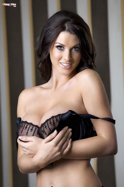 Alice Goodwin smiling holding bra