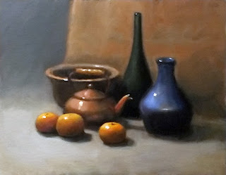 Still life oil painting of mandarines, a copper teapot, a brass bowl, a green bottle and a blue vase.
