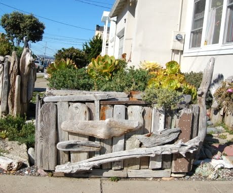 recycled drift wood garden fence
