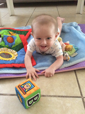 Life With Baby At Six Months Old - Baby Grinning On Floor Mat