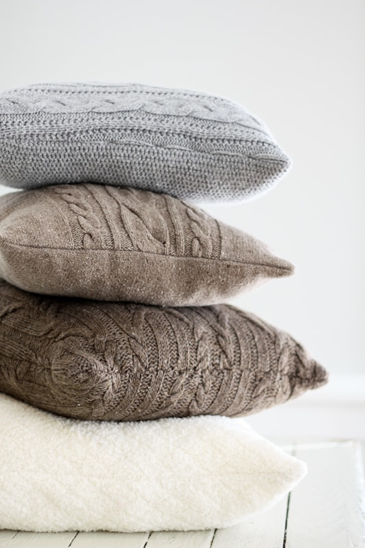 Cozy up in your farmhouse living room this fall with these recycled sweater pillow covers