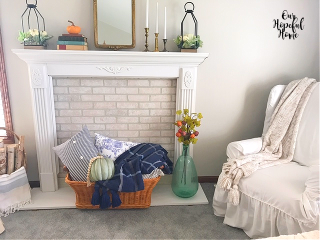 salvaged mantel fall decor vintage laundry basket throw blanket pillows