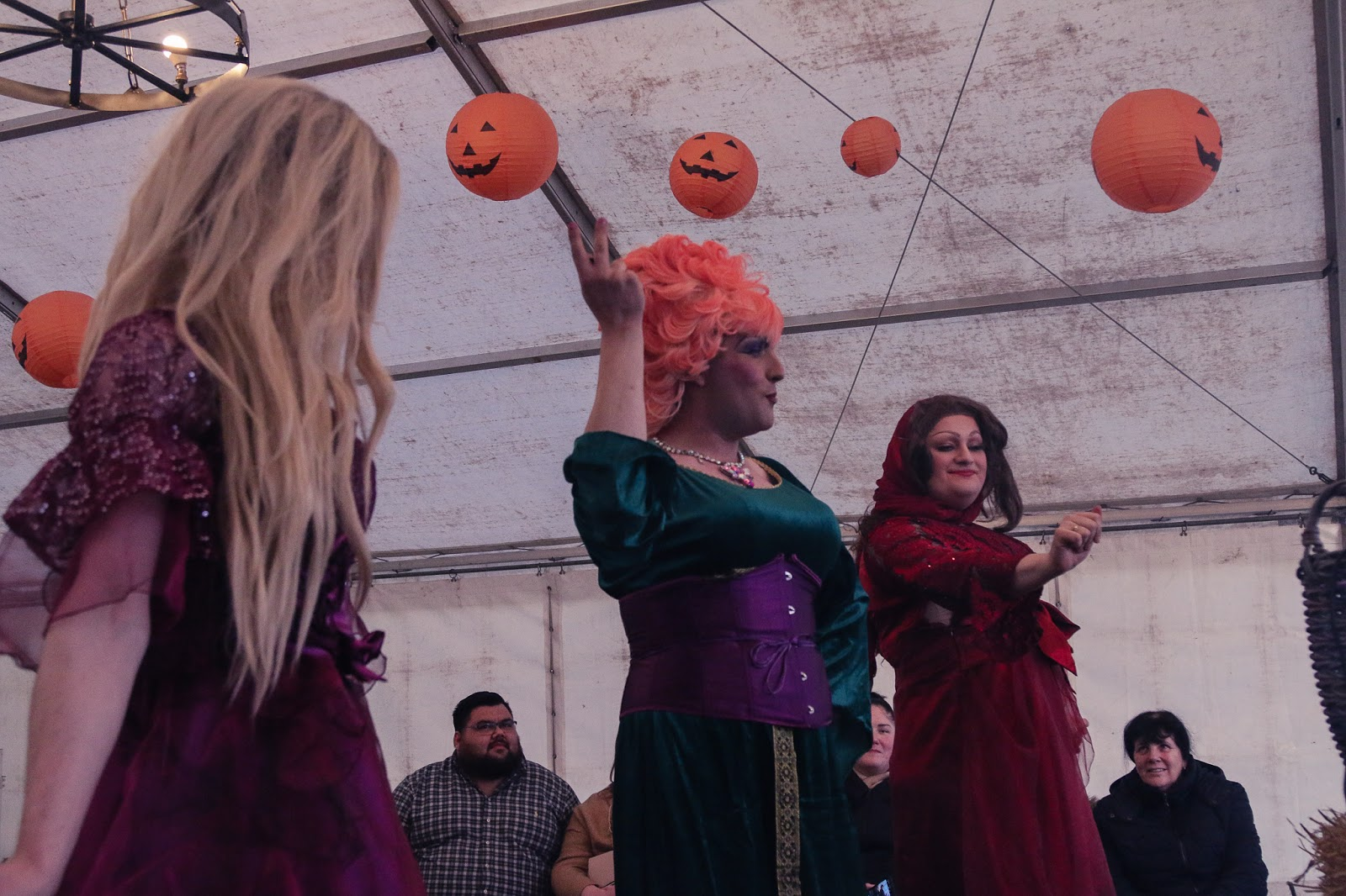 Mid shot of the three witches dancing at the M&D's pumpkin festival - Three drag queens dressed up as the three hocus pocus witches dancing.