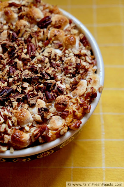 close up image of lightened up sweet potato casserole topped with marshmallows and nuts