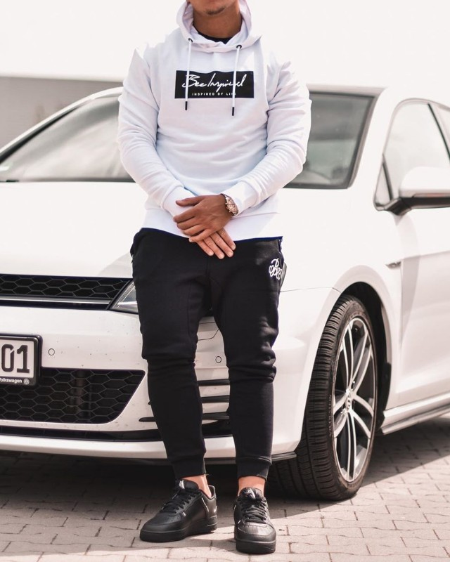 A man wearing Athleisure outfit, white hoodie and stretchable joggers.