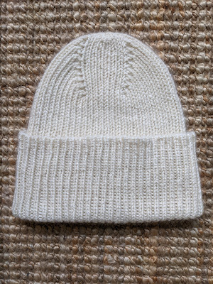 The completed Stockholm Hat with its folded cuff laying on the floor