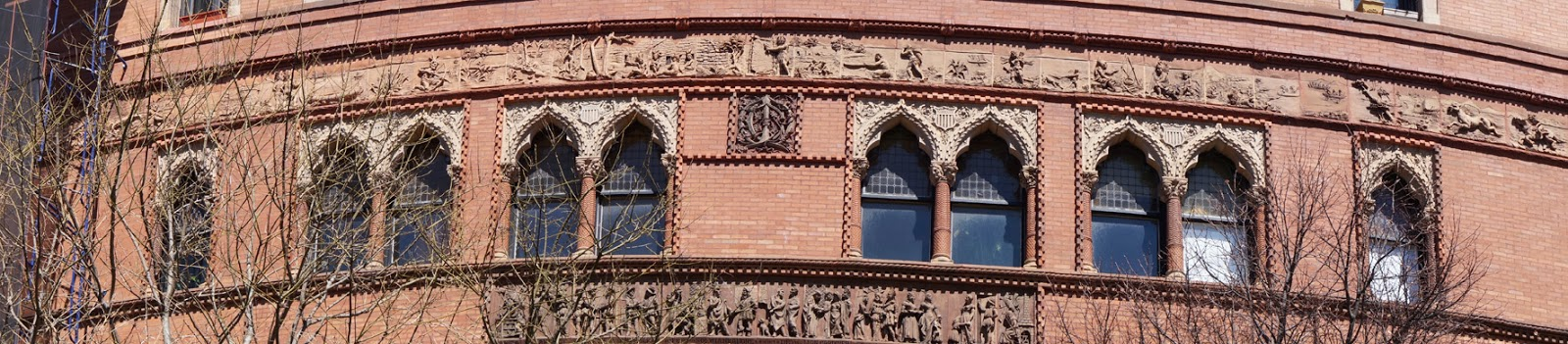 Panoramic image of the terra cotta Montauk Indian narrative ornamentation