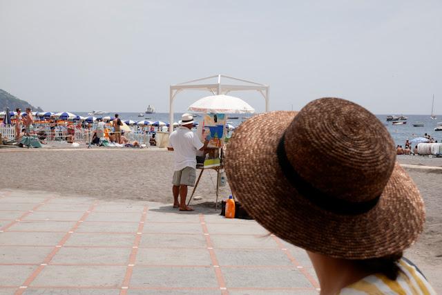 Positano, pittore sulla spiaggia