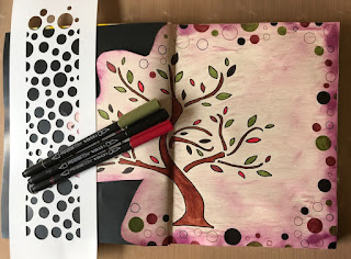 image tree outline in art journal with coloured brush markers and stencil