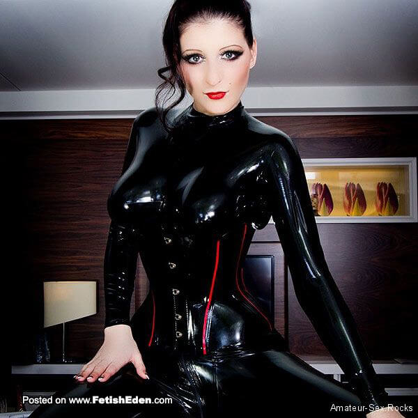 Sexy black-haired woman wearing black latex corset