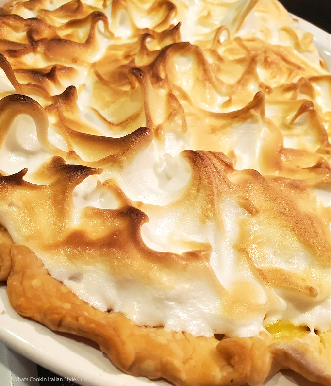 this is a homemade from scratch lemon pie with meringue nicely browned on top