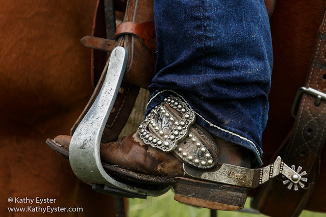 cowgirl boot in stirrup with spur