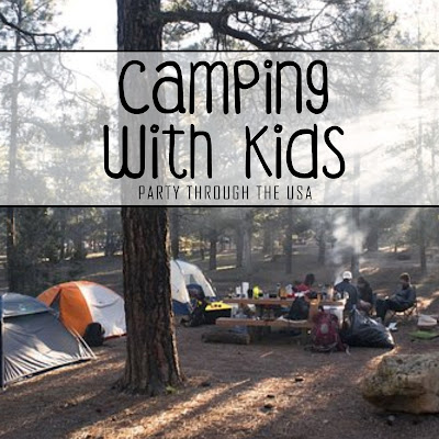 "Picture of a family camping with text overlay saying ""Camping with Kids."""