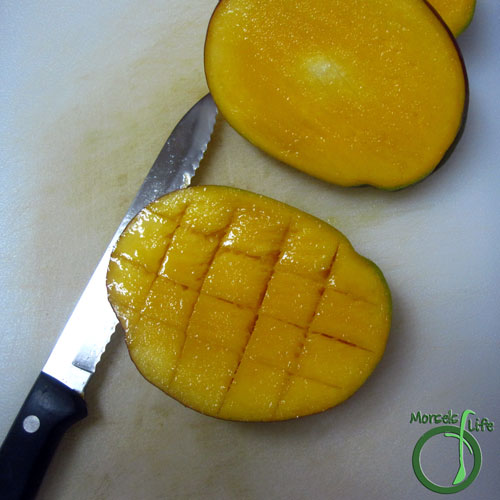 Morsels of Life - How to Cut a Mango Step 3 - Cut a cross hatch pattern into each side of the mango, making sure not to cut the skin.