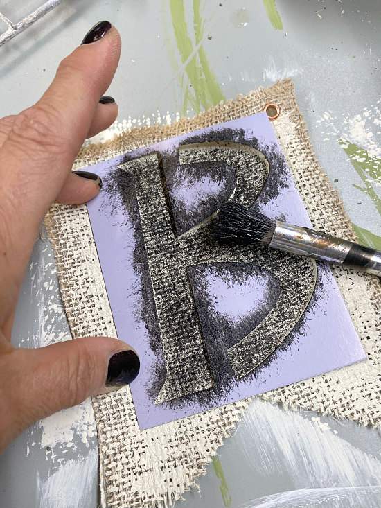 Stenciling a B on a burlap flag