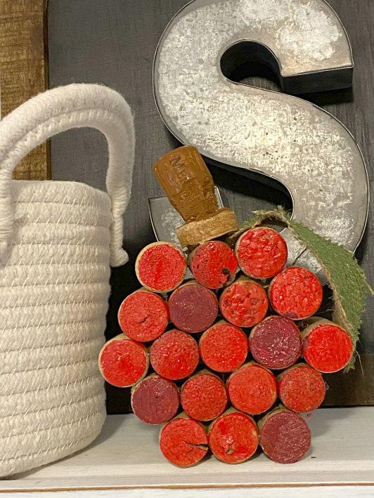 Wine cork apple on the shelf with galvanized S