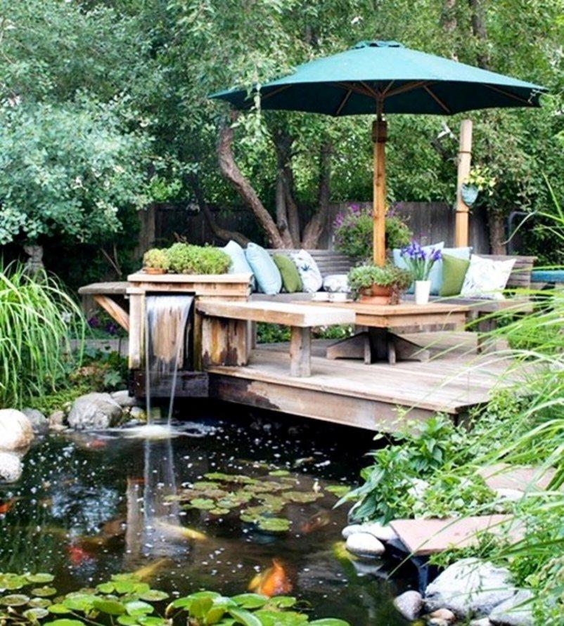 taman rumah minimalis dengan kolam ikan yang terbaru