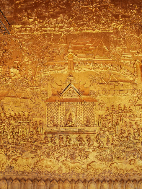gilded reliefs on the wall at Wat Mai